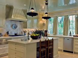 two hanging lights kitchen chandelier with white kitchen island and stools also custom wooden range hood