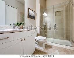 Transitional bathroom ideas Bathroom Remodel Beige And Gray Bathroom Transitional Bathroom Interior Design In Soft Beige Colors Features Glass Shower With Ghanacareercentrecom Beige And Gray Bathroom Transitional Bathroom Interior Design In