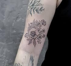 фото татухи полевых цветов на бицепсе девушки фото рисунки эскизы