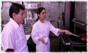 scene from gordon ramsay s kitchen nightmares where chef julieta instructs fiesta sunrise cooks on how to
