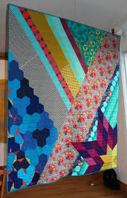 Oh what wonderful ideas this brings to mind, so many fabrics and ... & That is a cool quilt with all the color and different patterns. Spectacular  layout in this modern quilt Adamdwight.com