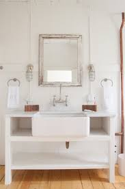 ideas using farmhouse sinks along with vintage double wall sconces and paint wood framed vanity mirror top notch for bathroo decoration lamps plus