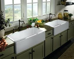 two units of white farm sinks for kitchen with black wrought iron water faucets grey farmhouse top mount a front sink wall farm redo kitchen