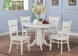 nice white traditional round pedestal kitchen table and 4 white chairs set featuring brown rug