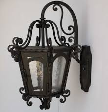 lights of tuscany outdoor inspirations also attractive wrought iron lighting fixtures ideas swing table railings