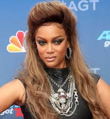 tyra banks wearing a statement necklace from glynneth b jewelry
