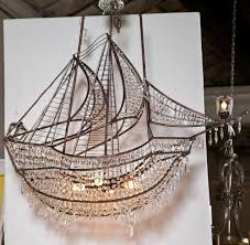 attractive and interesting decorative wrought iron ship chandelier decorated with crystals and prisms