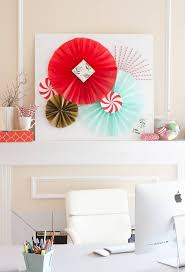 learn how to make diy tissue paper fans to create photobooth backdrops or holiday fireplace decor