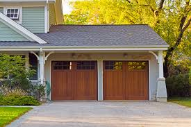 two wooden car garage residence