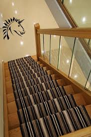 oak staircases with panels of glass for the barades