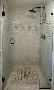interior black shower on white tile wall and glass shower stall door with black handle