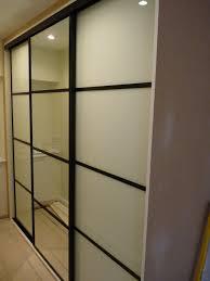 custom built sliding door wardrobes soft white mirror glass black frame mdf trim you