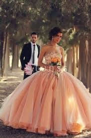 custom made blush pink colored strapless sequins wedding dress
