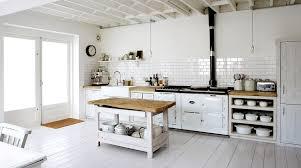 white kitchen rustic country white wood floors subway tile backsplash