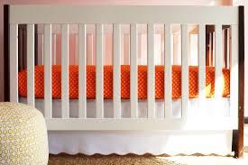 scallop crib skirt in white  orange trim  oliver b