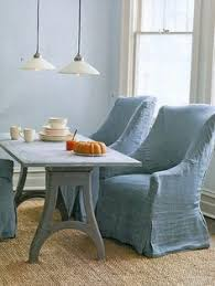 light blue linen slipcovers on dining table arm chairs