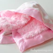 how to sew the softest diy baby blanket with two layers of minky fabric and satin