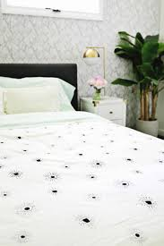 i love the pattern with fun details like those pretty gold side lamps too you can either pick two sheets with the same pattern color so the duvet is the