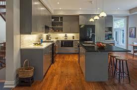 grey kitchens with black appliances