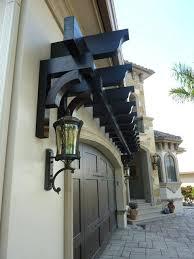 garage door arbor kits a trellis over adds nice architectural feature to home we iron trellis over garage door