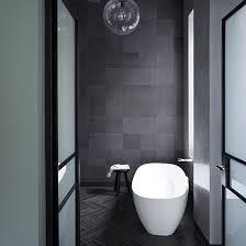Dark grey tile bathroom