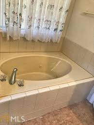 whirlpool tub without removing