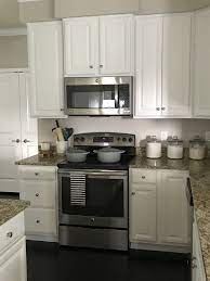 Swiss coffee is warm with a touch of greige. White Kitchen Valspar Swiss Coffee Cabinets Santa Cecilia Granite White Kitchen Paint Colors Painted Kitchen Cabinets Colors Paint Cabinets White