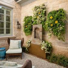 designs outdoor wall art: greens outdoor wall art completing exterior stone wall among fireplace also classic wall mount lamp