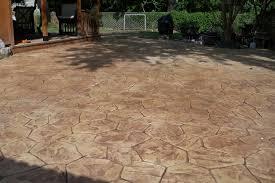 flagstone patio cost vs stamped concrete patio designs