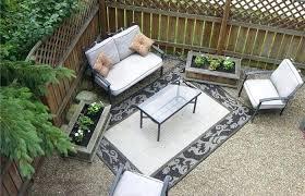 captivating pea gravel patio backyard with area rug