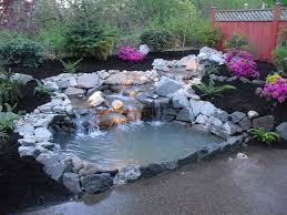 Lawn & Garden:Beautiful Backyard Pond Design With Stone Waterfall And  Pretty Purple Flower Ideas