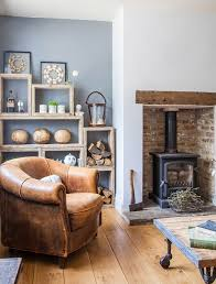 fireplace ideas woodburner and rustic wooden shelves in the alcove