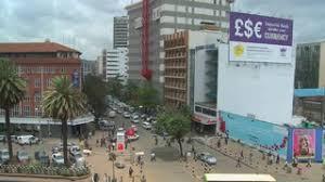 wide angle view busy design office. subscription library busy street scene in nairobi kenya wide angle view design office c
