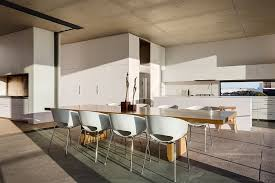 view in gallery large wooden dining table adds warmth and elegance to the open floor living space