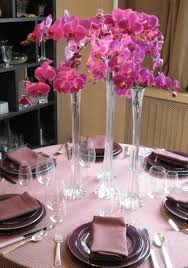 great image of wedding design and decoration using very tall round tapered glass flower vase including purple pink orchid pink and white flower wedding