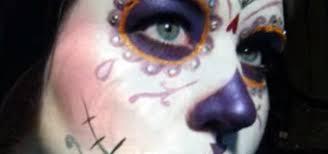 apply a purple sugar skull makeup look