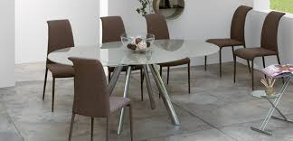 oval glass dining table. elegant oval glass dining table design with stylish brown chairs for modern inetrior