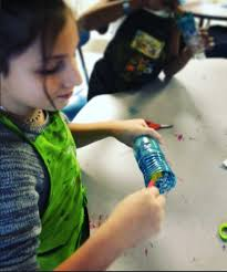 5th grade worked together on this bottle replica of dale chihuly s glass chandeliers very simple process we painted the inside of water bottles using warm
