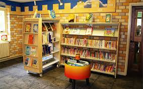 children s library furniture and shelving with a castle theme to the room
