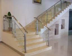 Glass And Stainless Steel Railing For Stairs And White Walls And ...