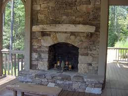 large stacked stone outdoor fireplace ideas