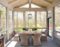 screened porch flooring porch farmhouse with wicker chairs traditional fire pits