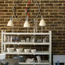 image modern kitchen lighting. kitchen with exposed brick wall neutral open shelves and pendant lamps image modern lighting