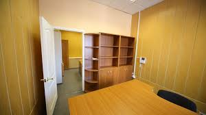 office rooms. Two Small Office Rooms With Empty Workplaces And Cabinets -