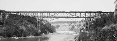 niagara cantilever bridge viewed from the south with a train passing over it whirlpool rapids bridge is just behind it