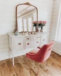 Anthropologie style furniture Modern Anthropologie Gleaming Primrose Mirror On White Vintage Vanity With Blush Pink Velvet Chair Image Via The Flooring Girl How To Style The Anthropologie Gleaming Primrose Mirror