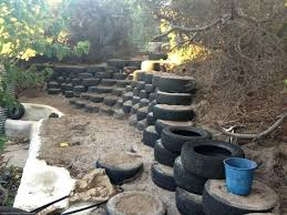 half finished retaining wall with steps this would make a good bunny free zone of tyre the tire wall