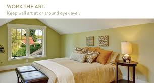 Use wall art for vaulted ceiling rooms