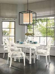 ivory key 5 piece round knapton hill dining table with mill creek arm dining chairs with quatrefoil diamond backs by tommy bahama home jacksonville