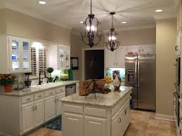 White kitchen cabinets, White Spring granite, Sherwin Williams China Doll  on the walls.